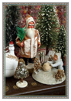 Vintage Christmas decorations with mica flake snowy accents