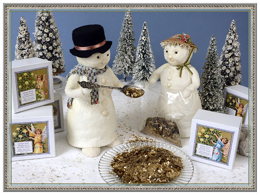 Snowman and snow lady with metallic mica flakes